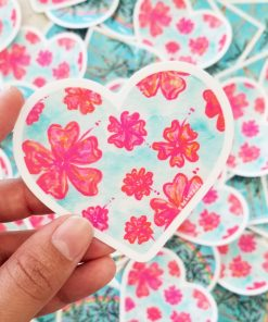 Hand holding a Flower Paradise sticker