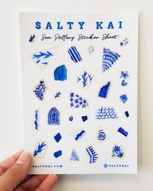 Hand holding a Sea Pottery Sticker Sheet