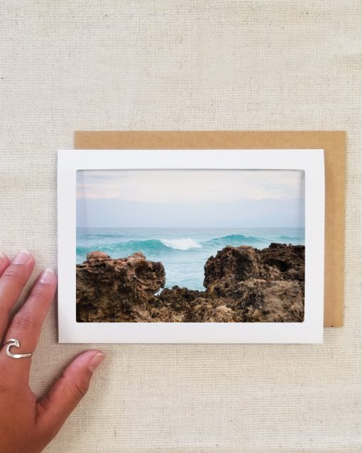 Photo greeting card laying on table with envelope