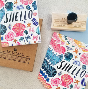 Group of shello cards on table with a stamp